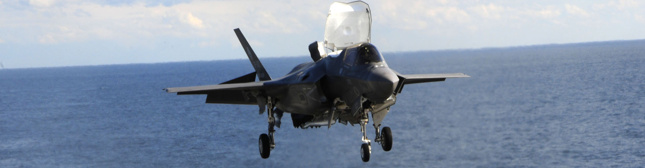The F-35B Lightning 11 prepares to vertically land for the first time at sea on the flight deck of the amphibious assault ship USS Wasp (LHD 1). The F-35B is the Marine Corps Joint Strike  Force variant, designed for short takeoff and vertical landing on Navy amphibious ships. The purpose of F-35B sea trials on USS Wasp (LHD-1) is to test F-35B systems and ship's support functions.
